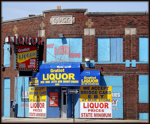 Knack Building, Gratiot Avenue: A Profusion of Signs for a Liquor Store--Detroit MI