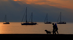 walking with the friend (rinogas) Tags: sardegna morning sea italy cloud sunrise boat sardinia pula rinogas