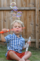 I'm Forever Blowing Bubbles... (iainthomson84) Tags: boy garden fun child play bubbles blow