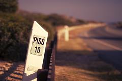 Piss10 (Furious Zeppelin) Tags: road sign nikon 10 secret valley piss pissouri d80