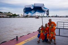 Monks and a broken parasol (srdjan s.) Tags: life sea people orange colors river thailand boat colorful asia southeastasia bangkok monks parasol chaophraya 2013