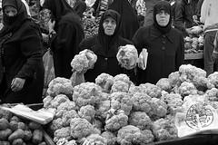 Syria - Aleppo (luca marella) Tags: street people bw white black blackwhite women market middleeast social pb bn bianco nero siria halab cauliflowers marellaluca