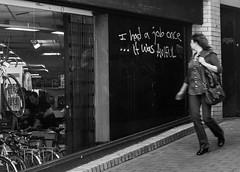 I had a job once! (Adeypoos) Tags: street urban blackandwhite bw girl 35mm walking graffiti brighton fuji employment candid statement job aphorism x100 stphotographia streetlevelphoto streettogs ilobsterit adrianpollardphotography adrianpollardstreetphotography