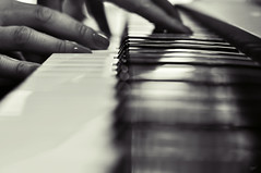 Love for music and B&W (eggii) Tags: light bw music dof hand time bokeh piano vision:sky=0695 loveformusicandbw