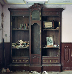 (moggierocket) Tags: old brown abandoned 120 6x6 film radio furniture antique interior room books dirt frame dust piece bookcase abandonment fallingapart dishevelled bronicasqa