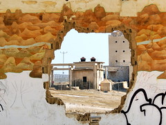 Hole view (markb120) Tags: house mountain building wall painting israel break hole map gap deadsea breach