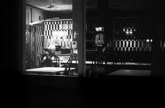 seul en scne (gguillaumee) Tags: street old urban canada man film night dark lights restaurant alone loneliness quebec montreal candid grain dramatic kodaktrix lonely sorrow leicam7 summicron50mm pushed1600iso