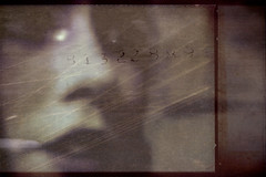 (Mei Todd) Tags: portrait blur texture girl face blurry scratches numbers