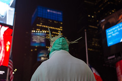 Times Square (moony: stupidly dreamy) Tags: nyc travel people newyork night square lights cityscape bokeh streetperformer times statueofliberty performer