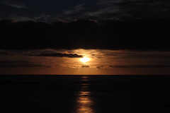 Moon or Sun? (mariacamussi) Tags: ocean longexposure light sea vacation sky orange naturaleza moon reflection beach nature night clouds digital reflections landscape uruguay seaside natur atlantic fullmoon moonrise shore uruguaynatural canon7d