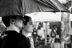 Sheltered... (Periades) Tags: blackandwhite bw girl umbrella blackwhite noiretblanc streetphotography nb fille parapluie photoderue streethuman