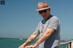 Anacapa Island Day Trip (Stephanie_Asher) Tags: ocean california blue sea summer man water hat birds canon 50mm boat losangeles gulls tattoos f18 nationalparks venturacounty channelislands seabirds anacapa polarizingfilter digitalrebelxti