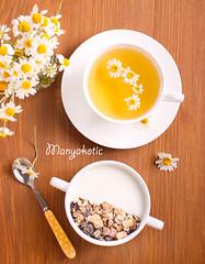 Muesli mix with yogurt in a bowl and chamomile tea (manyakotic) Tags: breakfast brunch chamomile diet flakes food fruits granola healthy herbs milk mix muesli nuts oats raisin snack sweet tea top treat view yogurt