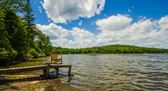 Rocking By The Lake (Catskills Photography) Tags: sky lake water clouds landscape dock chair rockingchair odc hbm canon1022mmlens withinthemoment