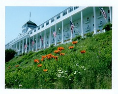 Grand Hotel, Mackinac Island MI (EllenJo) Tags: flowers summer vacation june mi polaroid hotel fuji michigan historic poppies fujifilm frontporch mackinacisland grandhotel tripwithmom uppermichigan 2016 polaroidlandcamera june23 instantfilm somewhereintime fujiinstant historichotel fujifp100c ellenjo ellenjoroberts adventureswithmom rollfilmcameraconvertedtopackfilm convertedpathfinder june2016 savepackfilm triptomidwest filminglocationofsomewhereintime