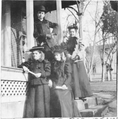 Four people in front of J.M. Olinger's porch (Meyersdale Public Library) Tags: houses people men women hats 1900s 1890s 1880s porches bowlerhats photobox12 cookalbum