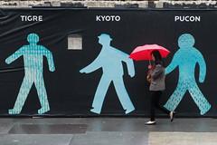 destination unknown (ho_hokus) Tags: nyc newyorkcity newyork art wet rain umbrella manhattan streetphotography pedestrian rainy publicart raining badweather x20 redumbrella 2013 mayabarkai walkingmen99 fujifilmx20