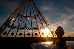 Pierre visits the world's largest tepee (just_jeanette) Tags: family sunset portrait orange sun canada mom monkey sock dad horizon alberta teepee tepee medicinehat