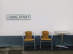 Chapel Street (Compactman) Tags: road street urban sign table lumix kent cafe chairs chapel panasonic seats roadsign deserted hythe unoccupied fz100