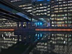 Bridge Over Relaxed Water (Deepgreen2009) Tags: bridge reflection london tower water lights mirror evening railway calm canarywharf offices