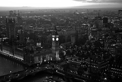 City of Tiny Lights (The_Kevster) Tags: leica city bridge light sunset sky blackandwhite bw london water monochrome westminster thames clouds buildings river lights shadows dusk housesofparliament bigben rangefinder landmark portcullishouse summicron50mm leicam9