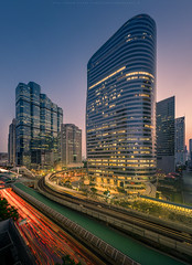Sathorn Sunset (Kwanchai_K) Tags: park city bridge blue light sunset sky panorama sunlight reflection building tower skyline night clouds skyscraper landscape thailand office high twilight nikon asia cityscape nightscape traffic top bangkok capital scene trail thai nightlight intersection tall bluehour rise skytrain trafficjam height beautifulview silom bts d800 sathorn bangkokview empiretower naradhiwas bangkokskyscraper beautifulviewofbangkok
