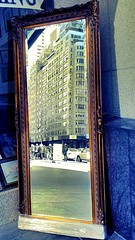 Mirror, Mirror on the Wall (damaris.reda) Tags: street wood nyc reflection building glass shop mirror store frame flickrstruereflection flickrstruereflection1 flickrstruereflection2 chameleonfilter