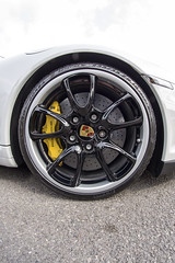 Yellow (Steven Vacher) Tags: cars car wheel tarmac circle photography westsussex outdoor wideangle tire porsche round vehicle rim 8mm supercar goodwood savage 2014 samyang goodwoodbreakfastclub savagephotography 4may2014