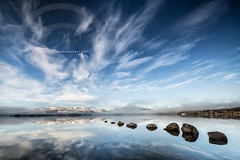 Bonnie Bank (RusseII Lees) Tags: sky cloud tree fog reflections bay rocks sony sigma sunny loch lomond 1020 millarochy milarrochy a6000 russelllees