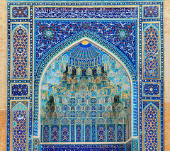 SAMARKAND/UZBEKISTAN - JULY 07: Arch portal with rich floral decoration in Ancient Mausoleum Gur Emir (Amir Timur tomb) on July 07, 2013 in Samarkand, Uzbekistan. It is one of the foremost interesting place in Central Asia (n_d_14021984) Tags: old city travel blue flower color art heritage history texture tourism beautiful architecture work vintage square religious temple design carved shrine colorful iran bright outdoor antique background madrasah muslim famous landmark mosque structure retro unesco arabic holy abundant ornament enter ornate orient build bukhara registan decorate magnificent element cultural islamic tamerlane