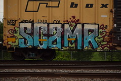 SCAMR (TheGraffitiHunters) Tags: street blue red white black green art car train graffiti colorful paint purple box gray tracks spray boxcar freight benched camr benching