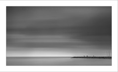 Somewhere Nearby XV (Frank Hoogeboom) Tags: sea white lake seascape haven black holland art water netherlands monochrome clouds landscape photography grey pier long exposure fotografie jetty fine smooth nederland glad filter zwart wit friesland ijsselmeer stavoren landschap lange sluitertijd occassion monochroom strekdam fczv