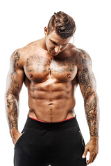 Tattooed muscular guy (cleancanvas) Tags: portrait people man sexy male guy beauty fashion sport tattoo dark studio naked one athletic cool healthy model power adult body masculine muscle expression muscular background handsome posing lifestyle latvia attractive strong torso bodybuilder athlete sensuality fitness hairstyle macho abs isolated fit stylish brutal individual caucasian fashionable hooligan tattooed deepshadows