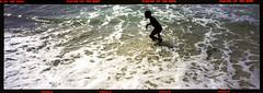 Boy playing in the waves, Diani Beach, Mombassa, Kenya. (tonywright617) Tags: africa boy sea 120 film waves kodak kenya panoramic analogue fujica medformat diani mombassa g617
