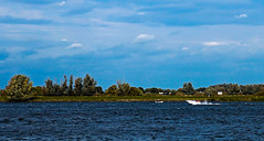 Nieuwe Merwede - Holland (Eduard van Bergen) Tags: county camera blue trees sun white holland green nature water netherlands colors dutch field grass lines clouds swimming river boats photo power wind outdoor farm sony ships horizon country farming picture meadows boote bateaux boten bikini photograph boating vista wife fields leisure farmer yachts alpha freetime pixels bas pays brabant ruff schiffe outboard biesbosch niederlande yachting oss rivier schepen badpak inboard ilce badeanzug linesman dashbord