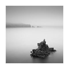 Precarious (Nick green2012) Tags: sea blackandwhite mist seascape rocks long exposure headland seastack