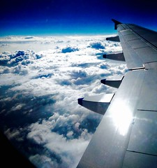 Flying through an ocean of thoughts (prasannakrish) Tags: floating light flying cloudythoughts journey high peace wind soaring glider wing whitewing horizon endless infinite sunshine morning travel planes bluelove ocean sea skies blue clouds windowseat airplane