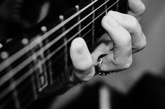 Fingers and frets (Occasionally Focused) Tags: blackandwhite bw monochrome mono hand pentax guitar fingers frets tonality justpentax smcpdal35mmf24al singleinjune2016