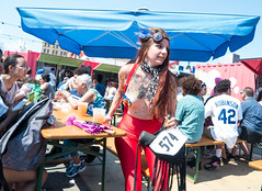 Redhead in Red (UrbanphotoZ) Tags: nyc newyorkcity red woman ny newyork leaves brooklyn scarf coneyisland eating tattoos redhead mermaidparade sequins redwhiteandblue 42 robinson studs pasties redtights coneyislandmermaidparade redsuspenders