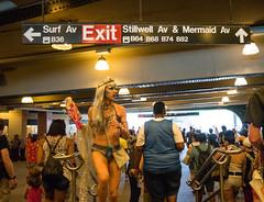 Against Traffic (UrbanphotoZ) Tags: nyc newyorkcity ny newyork glitter brooklyn bag subway coneyisland necklace crowd wig exit mermaid mermaidparade facepaint spectators siren headband barbiedoll surfav coneyislandmermaidparade stillwellav mermaidav