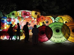 Parasol Parade (Feldore) Tags: street sun shop burma silhouettes olympus myanmar colourful 18 umbrellas burmese mchugh bagan parasols em1 17mm feldore
