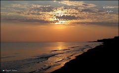 SILENZIO !!! (Salvatore Lo Faro) Tags: italy canon italia nuvole mare alba cielo sole puglia spiaggia rodi salvatore onde mattino gargano g16 risacca lofaro