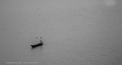 Alone (Xahid's Gallery) Tags: nature river boat blackwhite natur single bangladesh meghna slone
