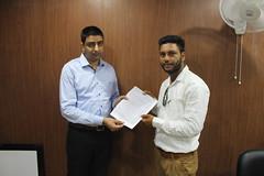 Mr. Gurvinder Singh Kang ( Director of West Highlander Chandigarh) handing over Cyprus Study visa to a client