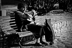 Love for the music (Wal CanonEOS) Tags: park street plaza parque portrait people blackandwhite bw music woman streets love byn blancoynegro argentina strange lady canon eos for monocromo mujer buenosaires day gente guitar retrato candid guitarra dia monocromatic musica streetmusic callejeando calles bsas seora caba monocromatico capitalfederal genteenlacalle villacrespo ciudaddebuenosaires portraitbw parquecentenario loveforthemusic musicacallejera argentinabsas bancodeplaza retratobyn ciudadautonoma peoplesstreet streetsbw amorporlamusica rebelt3 canoneosrebelt3 callesargentinas