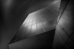 King of the wasteland (blondmao) Tags: stjakobpark glass building bnw switzerland facade stjakobturm windows clouds longexposure stjakobtower herzogdemeuron architecture dark bw sky concrete blackandwhite 13stopper basel
