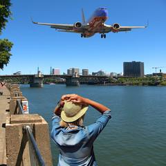 Fly By (swong95765) Tags: city woman hat plane river fly low jet perspective flaps