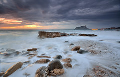 Primeras luces en Cala Baladrar [EXPLORE] (Javier_Lpez) Tags: sea sky sun seascape sol clouds marina nikon rocks long exposure dramatic sigma playa paisaje enero alicante amanecer cielo nubes javier angular 1020 olas roca cala larga elx elche calpe exposicin lpez dramtico benissa sedas d7000 baladrar javierlpez