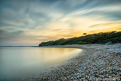 Ringstead Bay Dorset (chrisjonesphotography) Tags: chris sea england cloud seascape west tree beach water clouds bay coast jones south calm dorset coastline jurassic ringstead