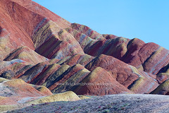 Zhangye Danxia Landform (baddoguy) Tags: china nature rock horizontal landscape outdoors photography colorful dusk nopeople landmark fairy geology multicolored rockformation mountainrange geological layered landform badland fantacy traveldestinations colorimage geopark naturalpattern gansuprovince zhangye dramaticlandscape physicalgeography